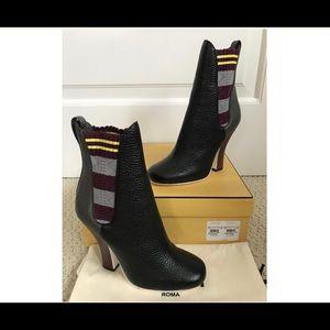Fendi black contrast striped gore leather boots.